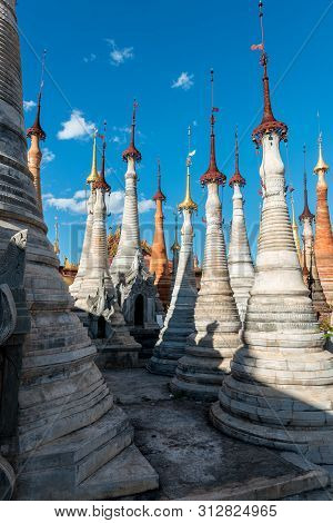 Inle Lake, Myanmar - 30 November, 2018: Vertical Picture Of Impressive Architecture Of The Stupas At