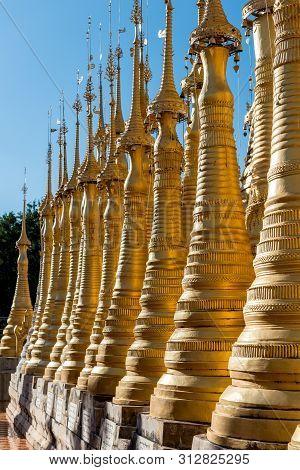 Vertical Picture Of Impressive Golden Stupas At Indein Temple, Landmark Of Inle Lake, Myanmar