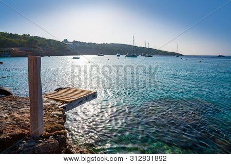 Ibiza Portinatx Arenal Gran beach sunset in Balearic Islands of Spain