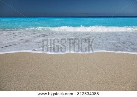 Sandy beach with white sand and turquoise sea water on the island of Lefkada, Greece
