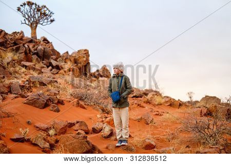 Young girl outdoor at Namib desert on cold winter evening