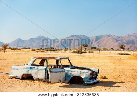 Abandoned old car near a service station at Solitaire in Namibia