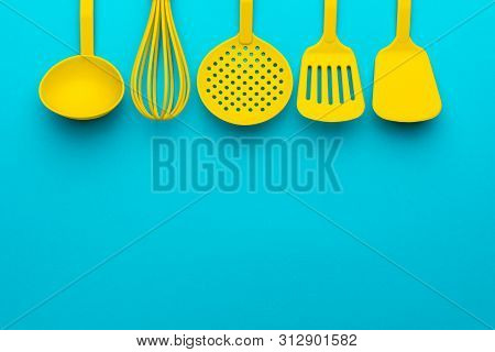Bright Plastic Kitchen Utensils - Cooking Concept. Flat Lay Image Of Different Utensils - Ladle, Whi