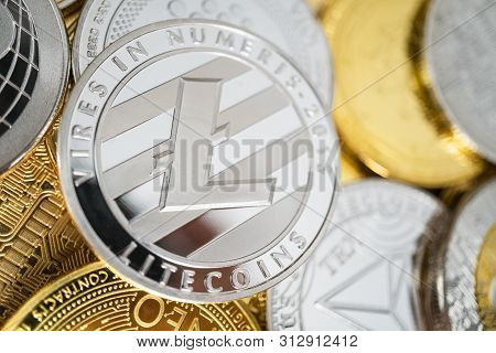 Litecoin Cryptocurrency Coin With Big Litecoin Symbol In The Centre Of It. Litecoin Physical Coin On