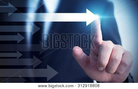 Businessman Pointing Arrow. Concept Of Business Success, Influencer, Opinion Leader And Benchmark