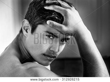 Portrait Of Muscular Hispanic Man Looking At Camera