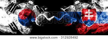 South Korea Vs Slovakia, Slovakian Smoky Mystic Flags Placed Side By Side. Thick Colored Silky Abstr