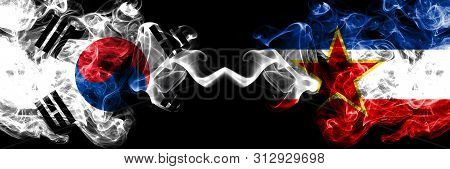 South Korea Vs Yugoslavia Smoky Mystic Flags Placed Side By Side. Thick Colored Silky Abstract Smoke