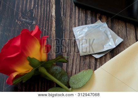 Condom Prevent Pregnancy Contraception Valentines Safe Sex Concept. Birth Control With Condom And Ro