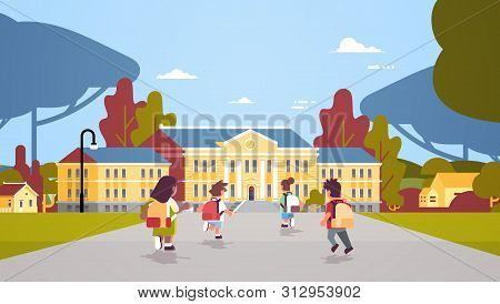Rear View Children Group With Backpacks Running Back To School Education Concept Mix Race Pupils In