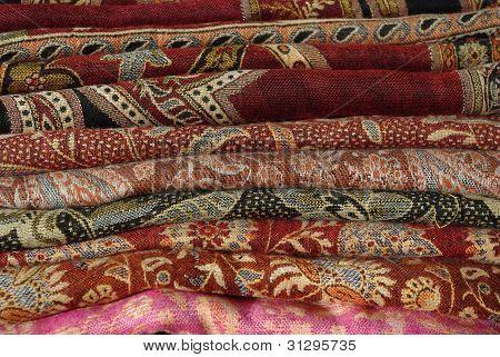 Pile Of Folded Colour Fabrics And Shawls
