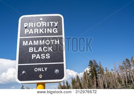 Mammoth Lakes, California - July 12, 2019: Sign For Priority Parking - Mammoth Black Pass For Pass H