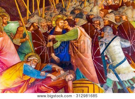 San Gimignano, Italy - September 26, 2017 Judas Christ Kiss Jesus Christ Medieval Renaissance Fresco