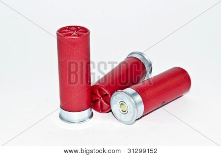 three red shotgun shells on white background poster