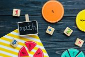 Creative ?olorful math fractions on dark background. Interesting funny math for kids. Education, back to school concept. Geometry and mathematics materials. Flat lay, top view poster