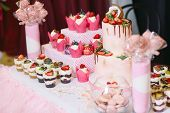 Wedding candy bar, trayfly, cakes and cake with fresh fruit. poster