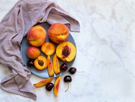 Plate With Peaches, Apricots And Cherries On Light Marble Background. Flat Lay, Top View.