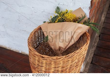 Mimosa Bouquet In Wicker Basket. Bunch Of Yellow Flowers On Veranda Home. Decor Spring Terrace. Home
