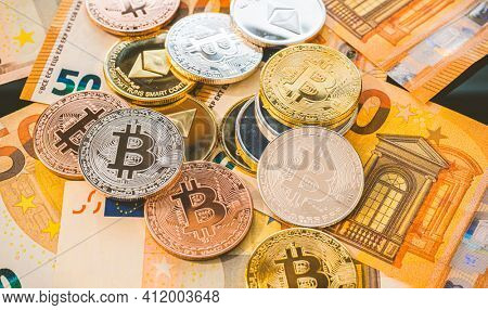 Bitcoin BTC coins on bills of euro banknotes. Worldwide virtual internet cryptocurrency and digital payment system. Digital coin crypto money on bitcoin farm in digital cyberspace