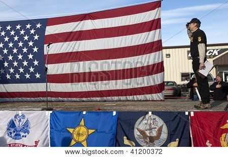 Oathkeepers Member Salutes The Flag.