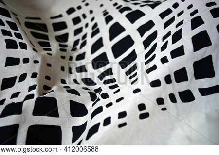 Ivory Cotton Fabric With Geometric Patterns Printed On It. Unusual Chaotic Lines And Black Shapes On