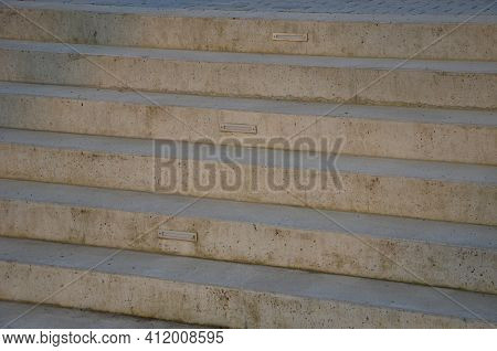 Gray Monolithic Concrete Park Bench Made Of Concrete In The Shape Of Round Stones Wooden Staircase B