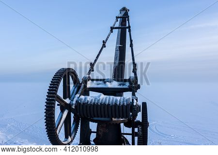 An Old Metal Crane At The Pier Of The Fourth Northern Fort Of Zverev. Kronstadt Fortress. Island Of