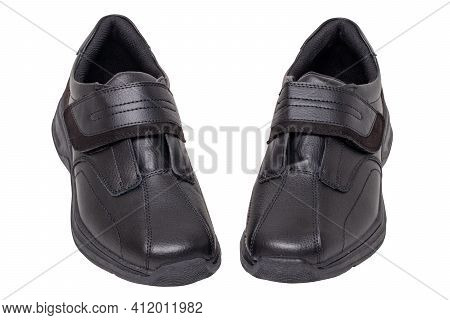 Mans Black Shoes. Close-up Of A Pair Of Black Sneakers Or Sport Shoes Isolated On A White Background