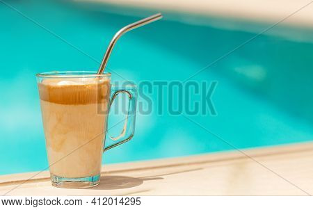 Greek Coffee Drink Called Frappe Coffee At The Edge Of A Swimming Pool