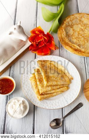 Pancakes With Jam And Sour Cream, Breakfast, Orange Flower, Spring, Womans Day. Traditional Russian