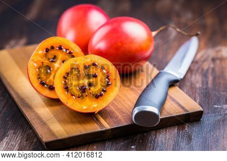 Organic tamarillo (tree tomato, Solanum betaceum) on cutting board