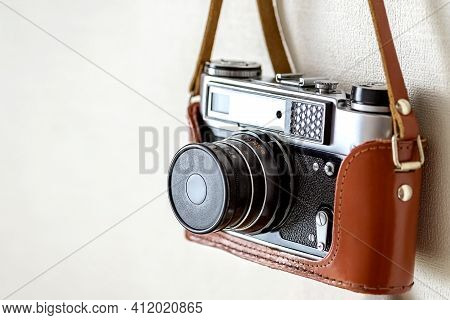 Old Vintage Film Slr Photo Camera In Leather Cover