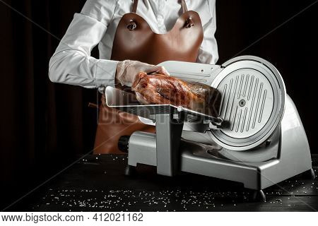 Dry Spanish Ham On Cutting Machine, Iberian Ham Cutter On Black Background.