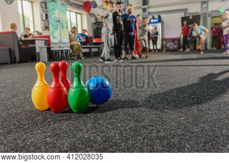 Dnepr, Ukraine- September 06, 2020: Group Of Excited Children Playing Bowling With Colorful Skittles