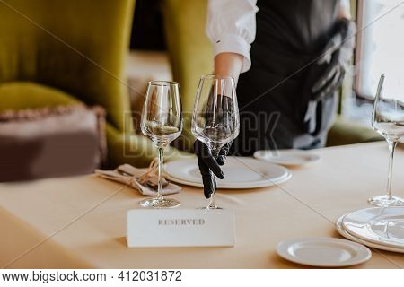 Lunch Tablecloth With White Plates, Glasses And Received Name Plate In Restaurant. Focus Is At Glass