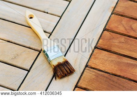Paintbrush On A Renewable Exotic Wooden Garden Table - For Background
