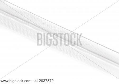 White Zipper Isolated On White Background. Clothing Fastener.