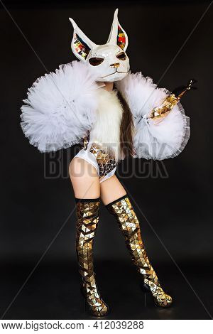 Beautiful Sexy Woman In Rabbit Bunny Mask And Carnival Costume Posing On Dark Background