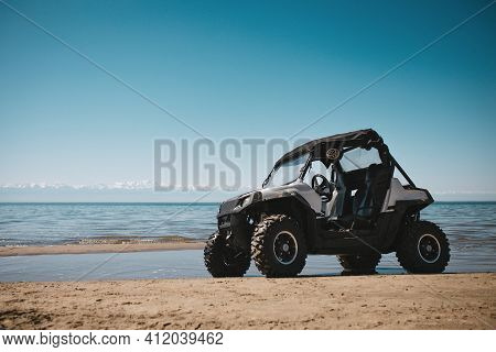 Beautiful Nature Landscape With Unknown Atv Near Lake Shore And Sky Background Panoramic View Of Ext