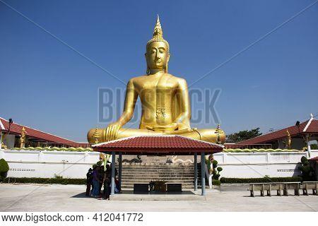 Golden Big Buddha Statue Of Wat Bang Chak At Riverside Chao Phraya River Near Koh Kret Island For Th