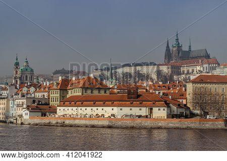 Postcard View Of Prague Castle In Mist From Charles Bridge,czech Republic.famous Tourist Destination