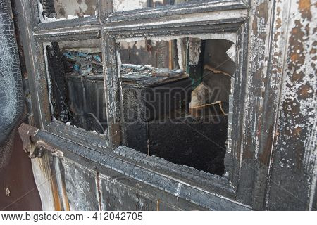 Charred Window Of A Burnt House Close-up