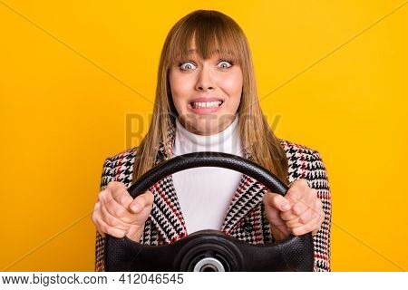 Portrait Of Horrified Person Hands Holding Steer Teeth Grin Look Camera Isolated On Yellow Color Bac