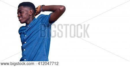 Young african american man wearing casual clothes suffering of neck ache injury, touching neck with hand, muscular pain