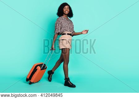 Photo Of Lady Go Carry Luggage Case Wear Leopard Print Shirt Shorts Footwear Isolated Turquoise Colo