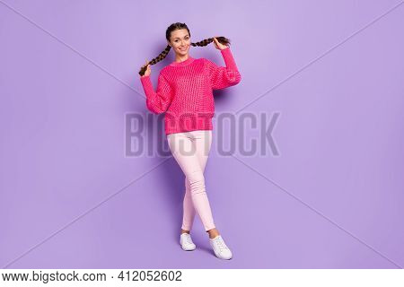 Full Size Photo Of Young Attractive Lovely Pretty Cute Sweet Nice Girl Pull Two Braids Isolated On P