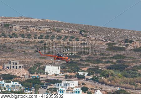 Paros Island, Greece- 26 September 2020: A Helicopter Of The Fire Brigade Extinguishing A Fire Off T