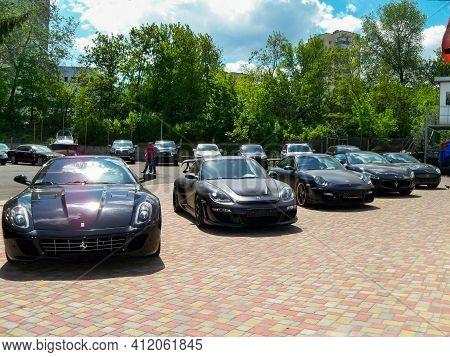 Kiev, Ukraine - May 14, 2011: Black Supercars Ferrari 599 Gtb Fiorano And Porsche 911 Turbo Gemballa