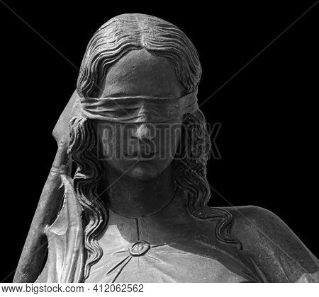 Lady justice or Themis Symbol of justice isolated on black background. Close-up of lady justice statue with blindfold