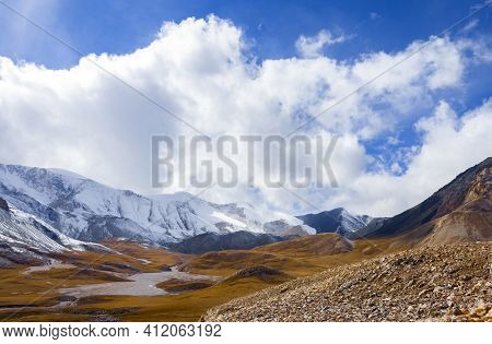 Cloudy Landscape Over A Mountain Pass During The Wind. Panorama Of A Mountainous Area With A Ridge A